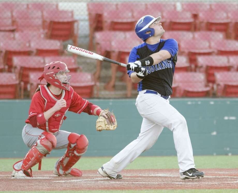 Midland Christian's Caleb Thomas hits a sacrifice fly into left field to score a run Friday during the Mustangs game against Grapevine Faith at Christensen Stadium. Cindeka Nealy/Reporter-Telegram Photo: Cindeka Nealy