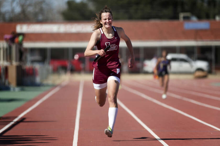 Lee's Tori Rackow finishes the girls 800 relay in the Tall City Relays on Saturday at Memorial Stadium. James Durbin/Reporter-Telegram Photo: JAMES DURBIN