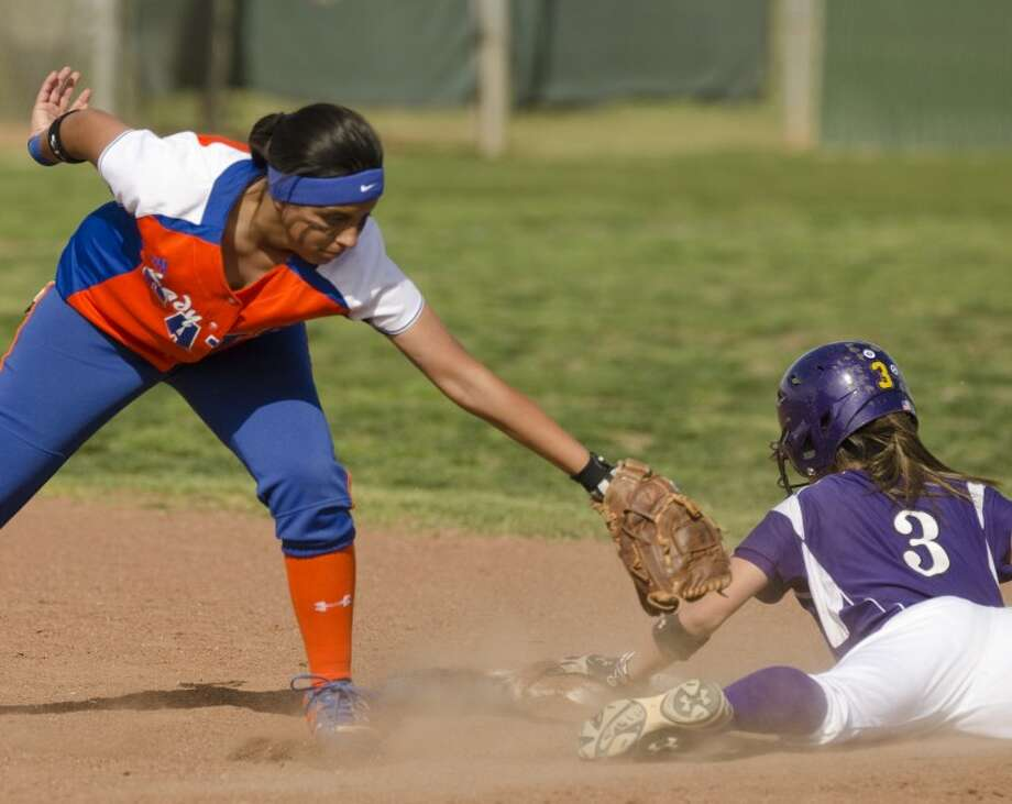 Midland High's Taylor Vines safely steals second as she slides wide out of reach of San Angelo Central's Shely Picasso Monday at Audrey Gill Sports Complex. Photo by Tim Fischer/Midland Reporter-Telegram Photo: Tim Fischer