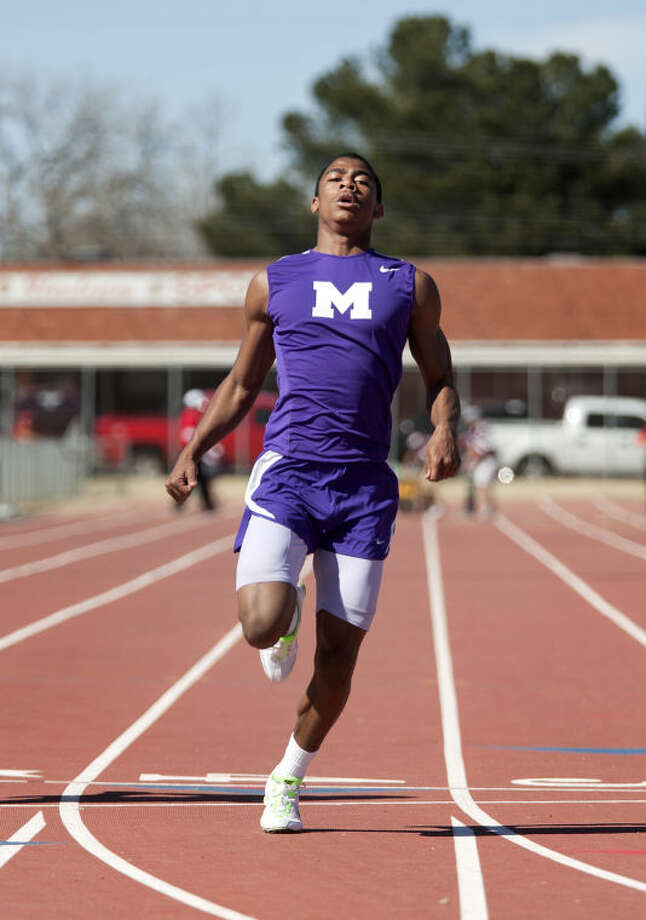 Midland's De'andre Goodley crosses the finish line after running in the boys 100 meter dash during the Tall City Relays on Saturday at Memorial Stadium. James Durbin/Reporter-Telegram Photo: JAMES DURBIN