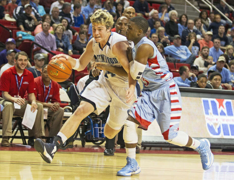 Greenwood guard Kam Williams tries to push past Hirschi guard Terrence Cooper during the game against the Wichita Falls Hirschi Huskies on Friday in the United Spirit Arena. Photo: Brad Tollefson