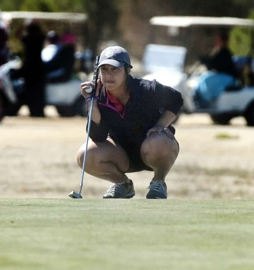 Midland Christian sophomore Christian Curnutte lines up a putt on Saturday during the final round of the Midland Girls Invitational on Saturday at Hogan Park Golf Course's Quail Course. Len Hayward/Reporter-Telegram