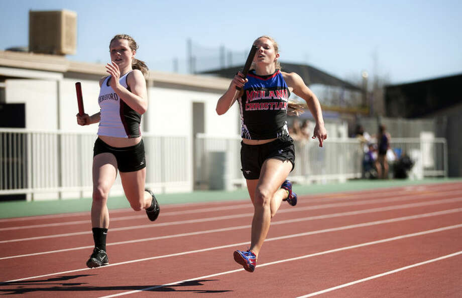 Midland Christian's Kami Berryhill (right) competes in the girls 800 relay during the Tall City Relays on Saturday at Memorial Stadium. James Durbin/Reporter-Telegram Photo: JAMES DURBIN