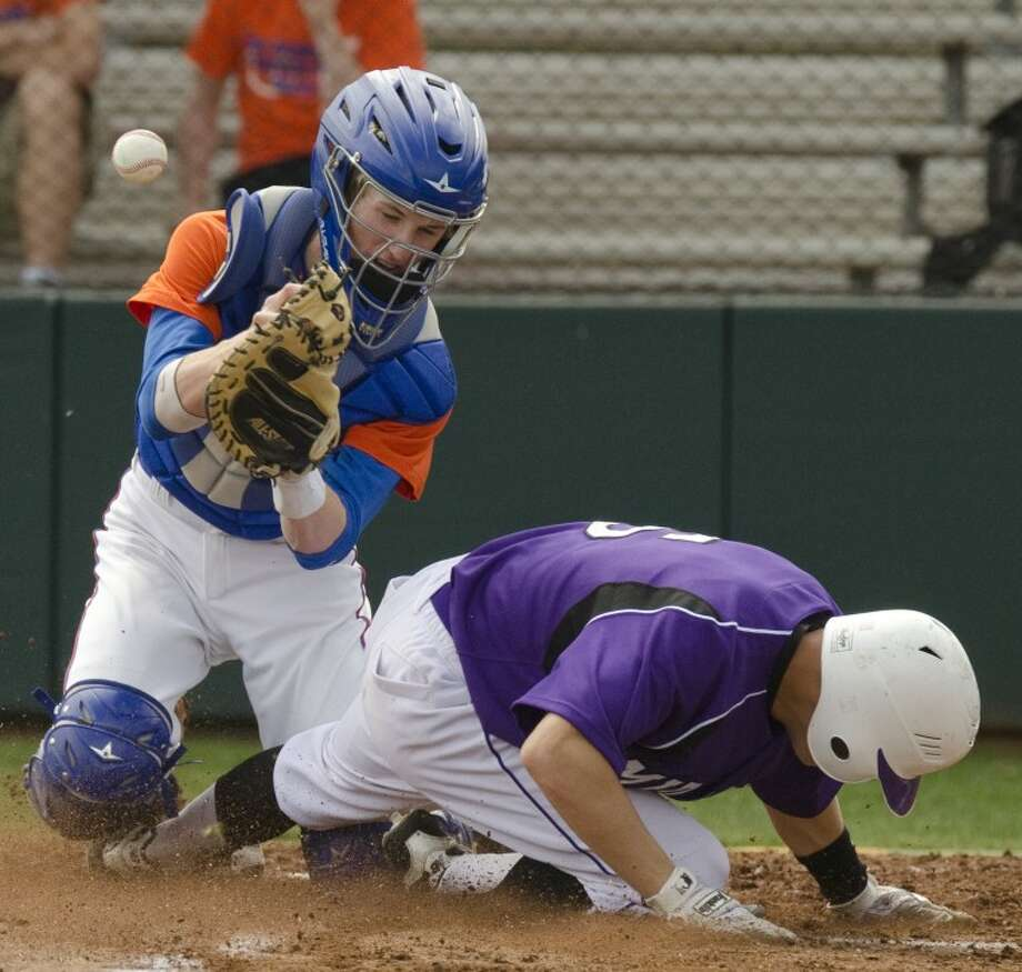 Midland High's Ryan Whittenberg slides in safely to home as San Angelo Central catcher, Logan Sawyer looses control of the ball Friday in a game at Zachery Field. Photo by Tim Fischer/Midland Reporter-Telegram Photo: Tim Fischer
