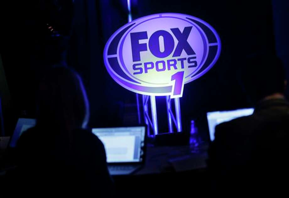 A logo for the new Fox Sports 1 channel is displayed during a news conference in New York, Tuesday, March 5, 2013. Fox says its new sports cable network will launch Aug. 17. (AP Photo/Seth Wenig) Photo: Seth Wenig / AP