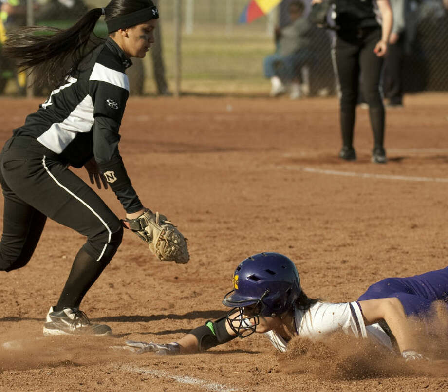 Midland High's Taylor Vines safely makes it back to first on a pickoff attempt as Permian's Natalia Ybarra looks to make the tag Tuesday at Audrey Gill Sports Complex. Tim Fischer\Reporter-Telegram Photo: Tim Fischer