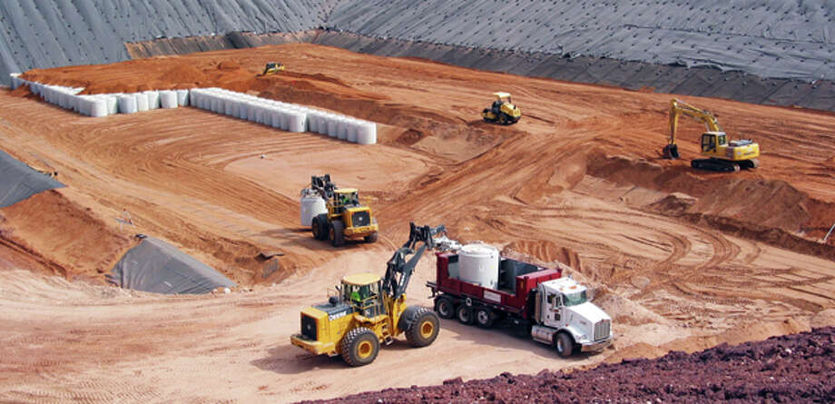 Waste Control Specialists bury some of the 3,700, 20,000-pound canisters of radioactive byproduct material from the Fernald uranium processing plant in Fernald, Ohio. The Low Specific Activity pad at Waste Control in western Andrews County began storing the canisters in 2005 and the disposal was conducted in 2009, according to WCS information Photo: Courtesy Photo / AP2009