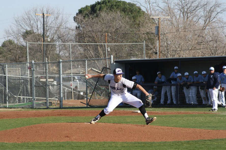 Midland High pitcher Michael Dominguez throws a pitch during Monday's game against Lubbock Monterey at Zachery Field.
