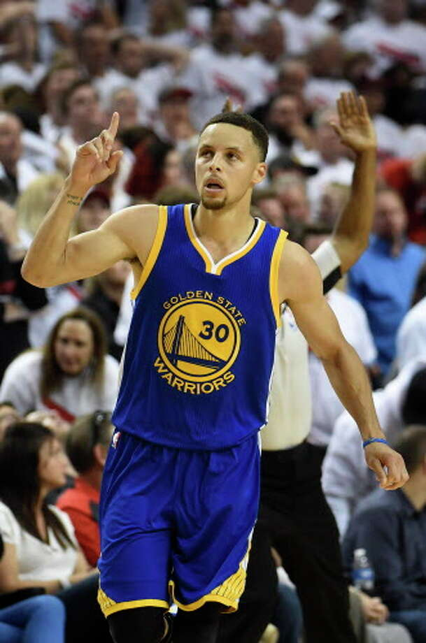 PORTLAND, OR - MAY 9: Stephen Curry #30 of the Golden State Warriors celebrates after hitting a shot during overtime  of Game Four of the Western Conference Semifinals against the Portland Trail Blazers during the 2016 NBA Playoffs at the Moda Center on May 9, 2016 in Portland, Oregon. The Warriors won 132-125. NOTE TO USER: User expressly acknowledges and agrees that by downloading and/or using this photograph, user is consenting to the terms and conditions of the Getty Images License Agreement.  (Photo by Steve Dykes/Getty Images) Photo: Getty Images