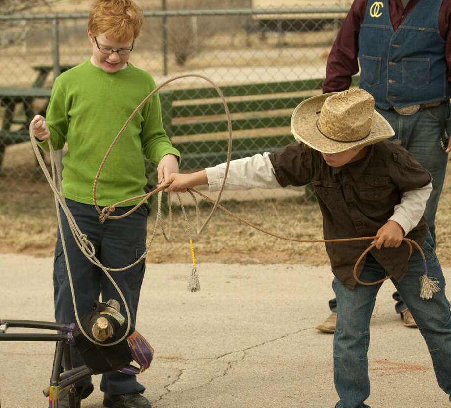 Timothy Lien and Sam Bustamante try their roping skills Friday as they and other Bynum School students participate in Texas Independence Day activities. Tim Fischer\Reporter-Telegram Photo: Tim Fischer