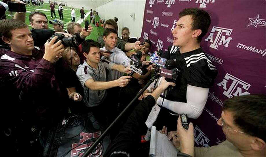 Texas A&M quarterback Johnny Manziel answers questions following a spring NCAA college football practice at the school's indoor practice facility, Tuesday, March 5, 2013, in College Station, Texas. (AP Photo/Bryan-College Station Eagle, Stuart Villanueva) Photo: Stuart Villanueva / Bryan-College Station Eagle