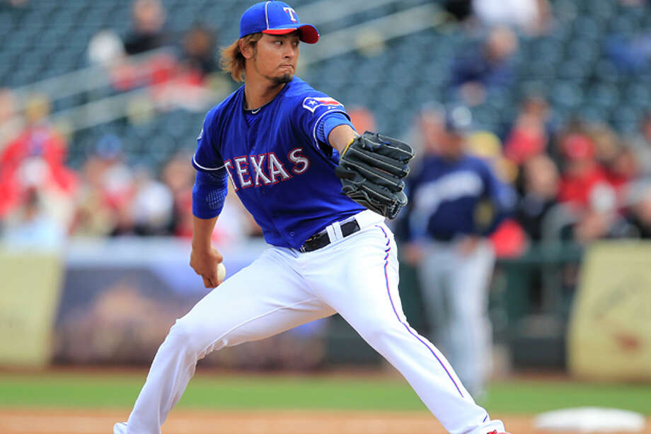 Texas Rangers' Yu Darvish throws in the fourth inning in a spring training game against the Milwaukee Brewers on March 19, 2012, in Surprise, Ariz. (AP Photo/Ross D. Franklin) Photo: Ross D. Franklin / AP