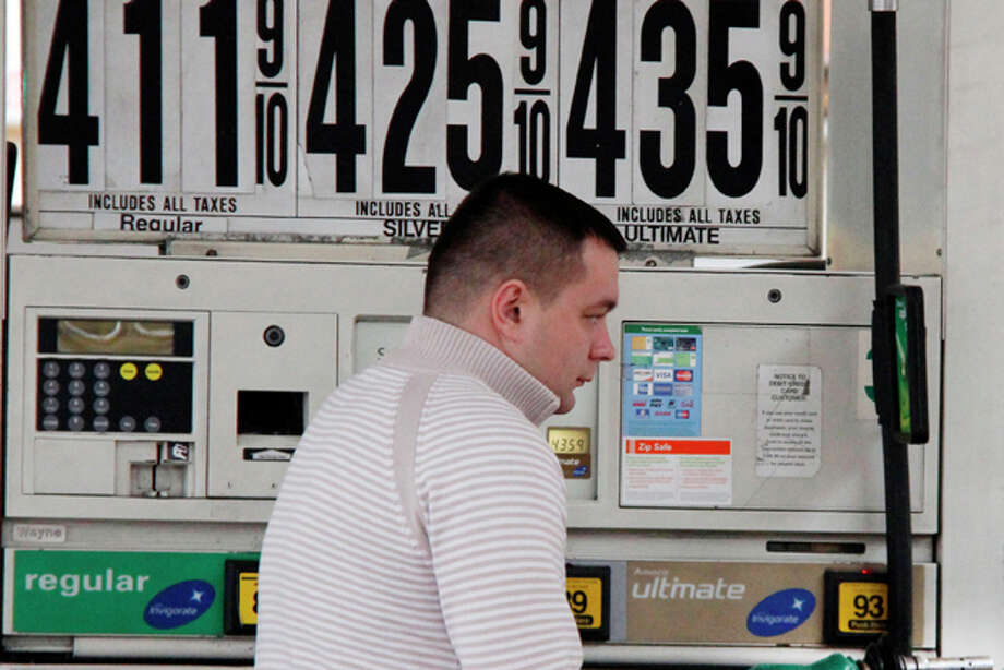 In this March 2, 2012 photo, a New York City taxi driver pumps gas at a BP mini-mart, in New York. Experts say pump prices are rising on the expectation that supplies will dip next month while refineries switch from winter to summer gasoline blends. Forecasts see gas rising as high as $4.25 per gallon in late April. (AP Photo/Gene J. Puskar) Photo: Gene J. Puskar / AP