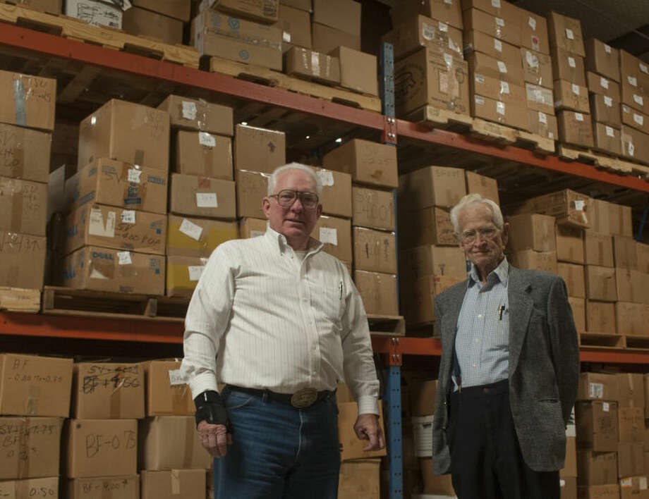 Garland Tiner and Ike Fitzgerald stand in the warehouse Tiner organized for the hundreds of thousands of pairs of glasses that are recycled by the Lions Club, through a program started by Fitzgerald years ago. Tim Fischer\Reporter-Telegram Photo: Tim Fischer