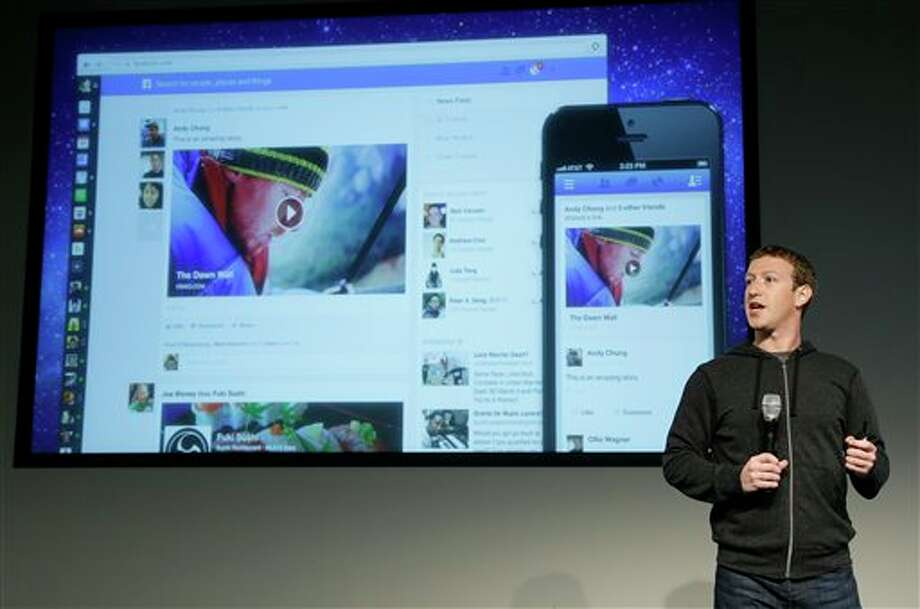 Facebook CEO Mark Zuckerberg speaks at Facebook headquarters in Menlo Park, Calif., Thursday, March 7, 2013. Zuckerberg on Thursday unveiled a new look for the social network's News Feed, the place where its 1 billion users congregate to see what's happening with their friends, family and favorite businesses.(AP Photo/Jeff Chiu) Photo: Jeff Chiu / AP2013