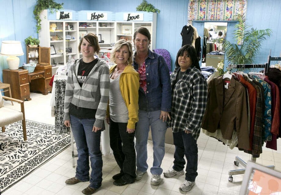 Twice Around Thrift Store volunteers and employees from left, Olivia Barlow, Chris Cupp-Lewis, Cassandra Kole and Lisa Gilbert Webb stand inside the store Wendesday, Feb. 27. James Durbin/Reporter-Telegram Photo: JAMES DURBIN