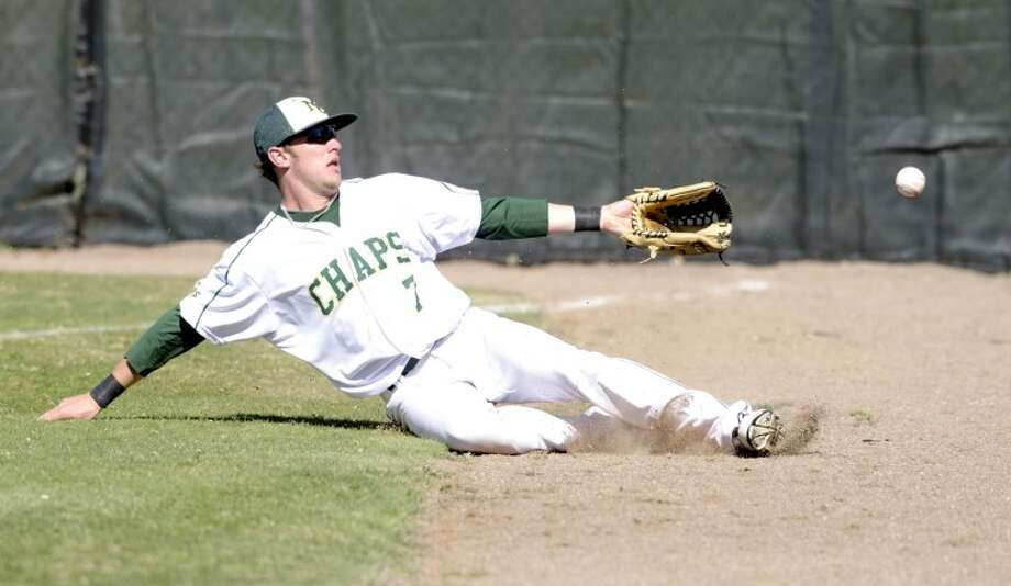 Midland College right fielder Blair Beck attempts to catch a foul ball Friday during game one of their doubleheader against Howard College at Christensen Stadium. Cindeka Nealy/Reporter-Telegram Photo: Cindeka Nealy