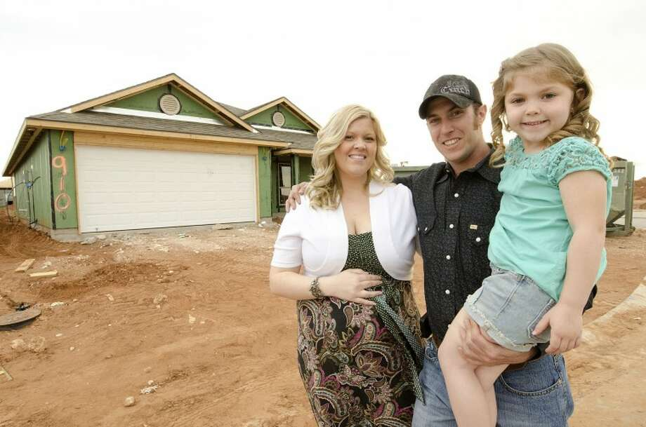 Ashley Skaggs, her husband Brent and their daughter Destiny, 5, are planning to move into their first home in Legends Park. Construction is expected to be completed on the three-bedroom and two-bath home in May. Cindeka Nealy/Reporter-Telegram Photo: Cindeka Nealy