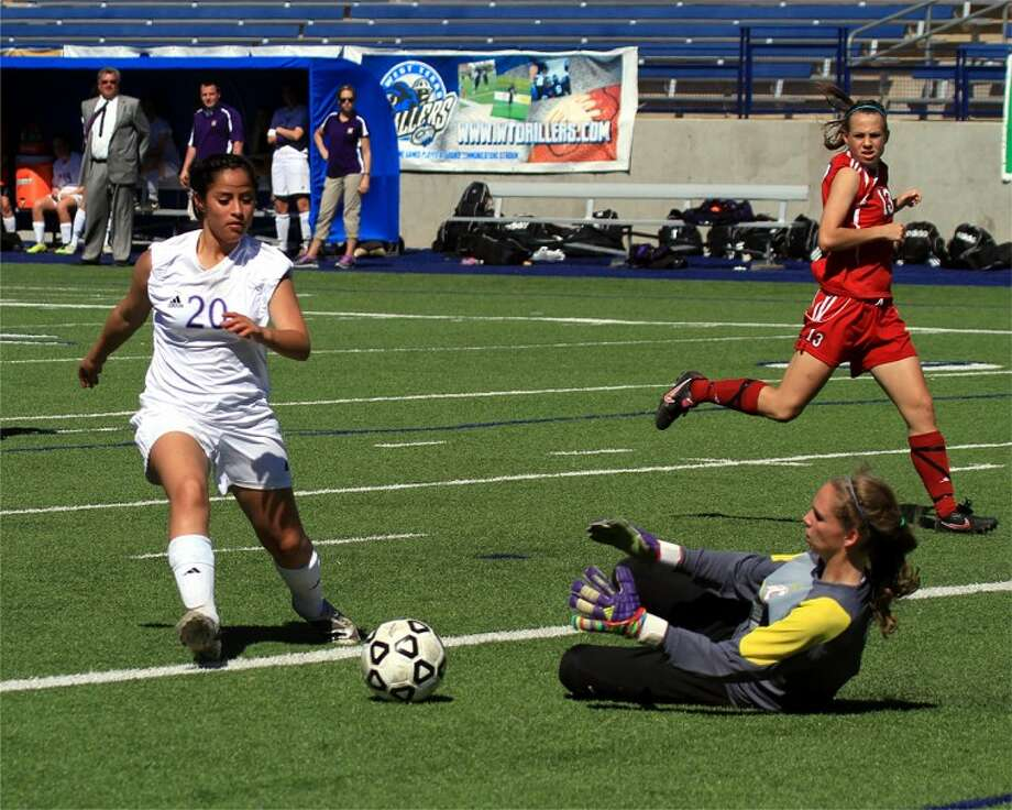 (File Photo) Midland High forward Selena Campos tries to work her way around the Abilene Cooper goalkeeper during Saturday's game at Grande Communications Stadium. Campos scored two goals in the Lady Bulldogs' 4-0 victory against the Lady Cougars. Ken Zoller/Special to the MRT