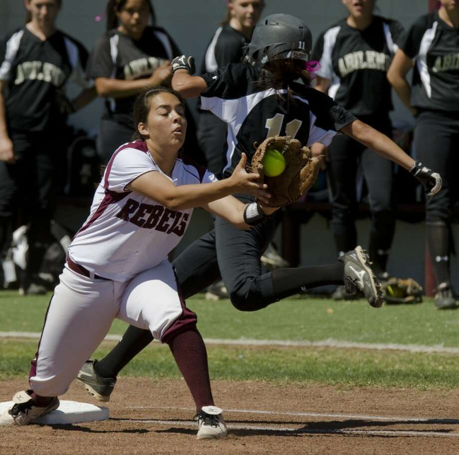 Midland Lee's Rosie Marquez stretches for the ball but Abilene High's Samantha Rodriguez is called safe at first on a bunt Saturday at Gene Smith Field. Photo by Tim Fischer/Midland Reporter-Telegram Photo: Tim Fischer