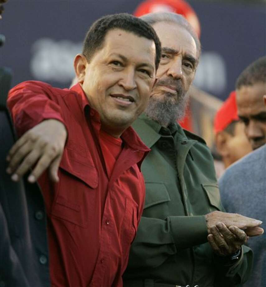 FILE - In this July 21, 2006 file photo, Venezuela's President Hugo Chavez, left, gestures as Cuba's President Fidel Castro looks on during an event in Cordoba, Argentina. Venezuela's Vice President Nicolas Maduro announced on Tuesday, March 5, 2013 that Chavez has died at age 58 after a nearly two-year bout with cancer. (AP Photo/Roberto Candia, File) Photo: Roberto Candia / AP