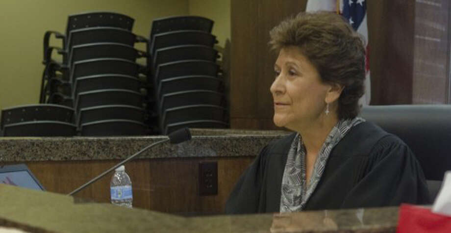 FILE - Judge Sylvia Chavez, child protection court judge, oversees court proceedings Nov. 16, 2011. Child Protective Services in Austin is sending extra CPS agents to the Midland and Odessa CPS offices to help clear a backlog of abuse and neglect cases within the agency.