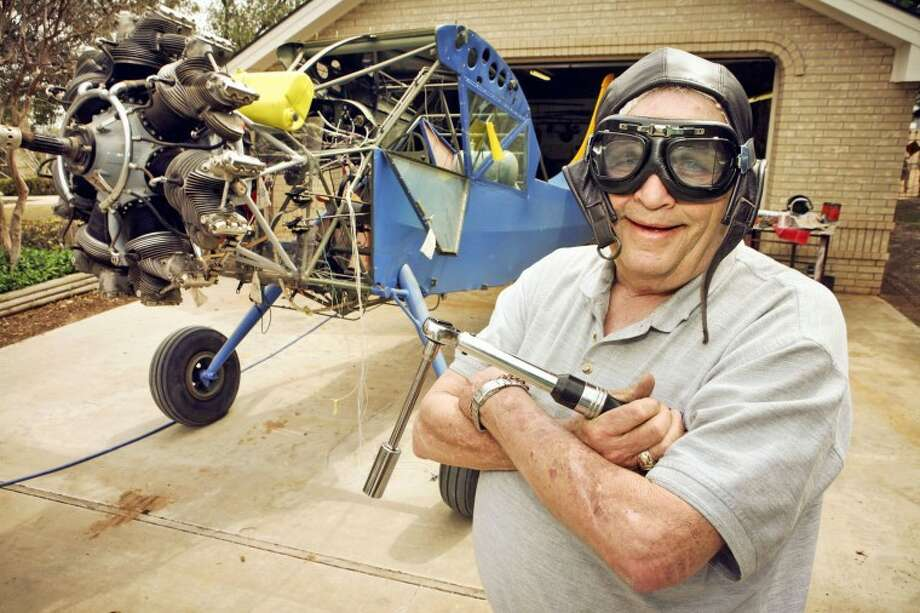 Physicist, inventor and aviator Fred Newman stands by a World War II era bi-wing Stinson L-5 that he is spending his free time, away from his oil and gas ventures, overhauling. Cindeka Nealy/Reporter-Telegram Photo: Cindeka Nealy