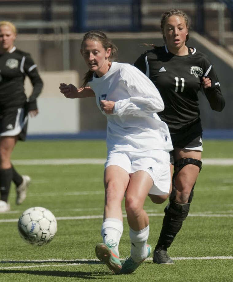 Midland High's Sarah Krisa passes the ball away as Permian's Sierra Bruingston defends Saturday at Grande Communications Stadium. Tim Fischer\Reporter-Telegram Photo: Tim Fischer