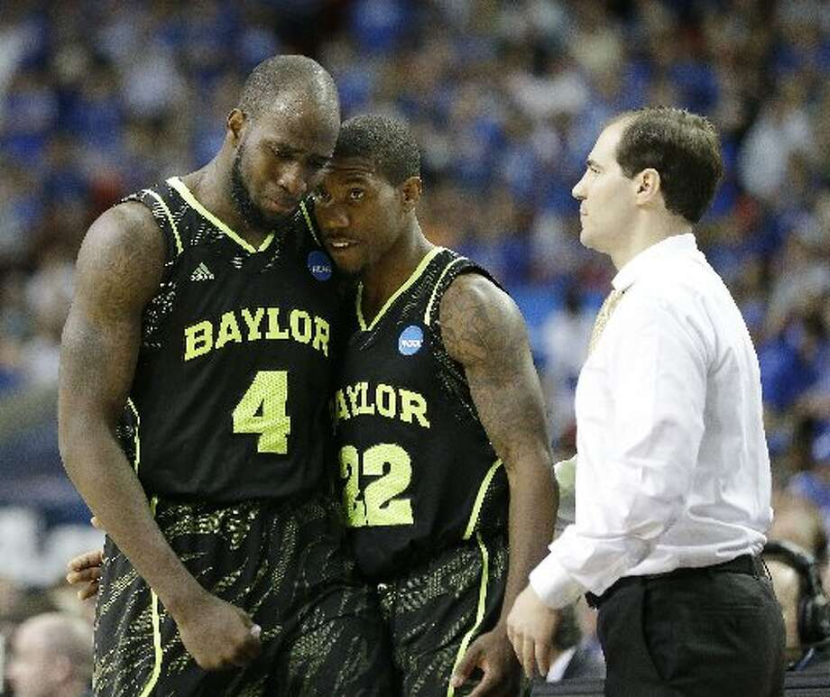 Baylor's Quincy Acy (4) and Baylor's A.J. Walton (22) walk by Baylor head coach Scott Drew in the closing seconds of the second half of an NCAA tournament South Regional finals college basketball game against Kentucky ,Sunday, March 25, 2012, in Atlanta. Kentucky won 82-70. (AP Photo/David J. Phillip) Photo: David J. Phillip/AP