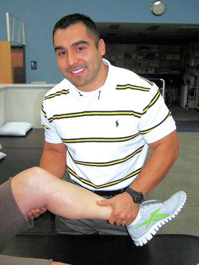 Andre Furtado, DPT, of COM Physical Therapy, says many clients want to continue their improvement on their own—and COM's fully equipped fitness center lets them do just that. Call 618-9952 for more information.