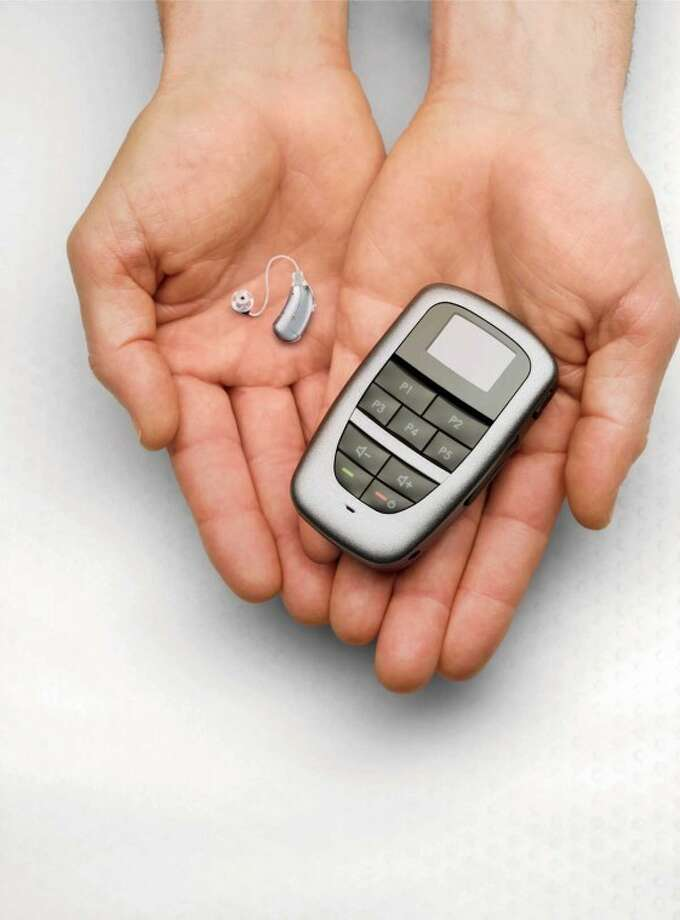 Trade in your old hearing aids for new technology, like the wireless hearing aid and remote pictured here.