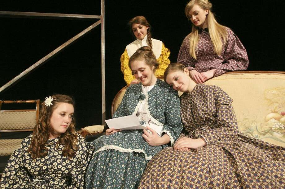 "Marmee (Alex Speight) reads a letter to her daughters Amy (Phage Nolte), from left, Jo (Michelle Smith), Meg (Bailey Brooks) and Beth (Brittany Jennings) March 15, during the Pickwick Players' rehearsal for ""Little Women"" at the Cole Theatre. Cindeka Nealy/Reporter-Telegram Photo: Cindeka Nealy"