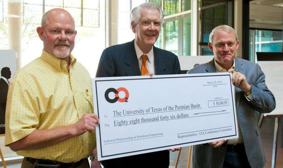 UTPB is $88,046 closer to establishing a $100,000 endowed professorship in petroleum engineering after UTPB President David Watts received a check from CO2 Flooding Conference planning committee members Mark Nicholas and Steve Melzer Wednesday. Since the conference was established more than 17 years ago, almost $480,000 in conference profits have been donated to UTPB. Photo: Courtesy Photo