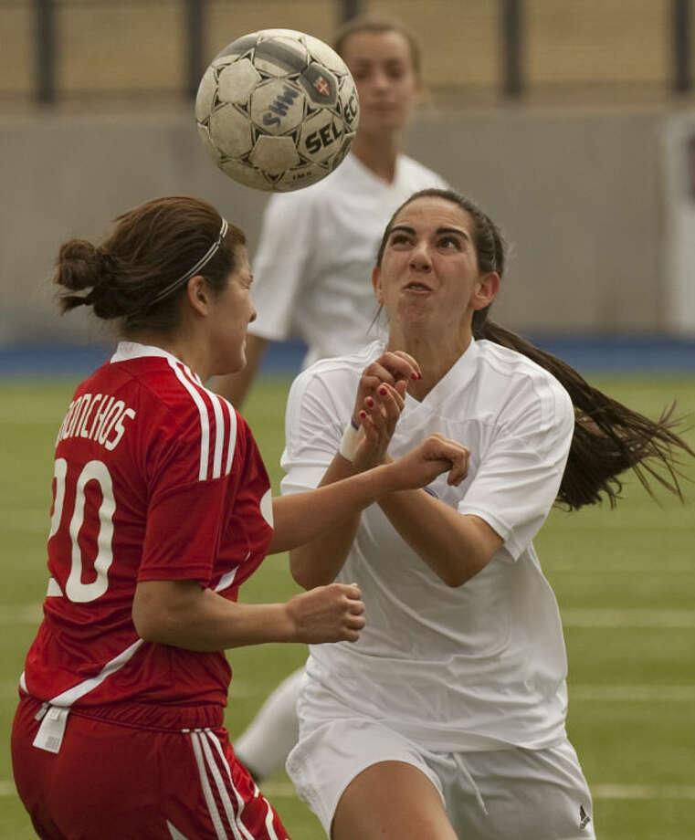 Midland High's Megan Hoppel battles Odessa High's Halie Vasquez for the ball Saturday at Grande Communications Stadium. Tim Fischer\Reporter-Telegram Photo: Tim Fischer