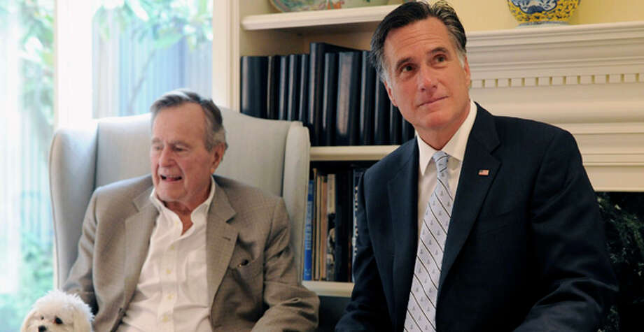 FILE - In this Dec. 1, 2011 file photo, Republican presidential candidate, former Massachusetts Gov. Mitt Romney meets with former President George H.W. Bush in Houston. The former president plans to endorse Mitt Romney, further urging the Republican Party to coalesce around the former Massachusetts governor's presidential campaign. (AP Photo/Pat Sullivan) Photo: Pat Sullivan / AP