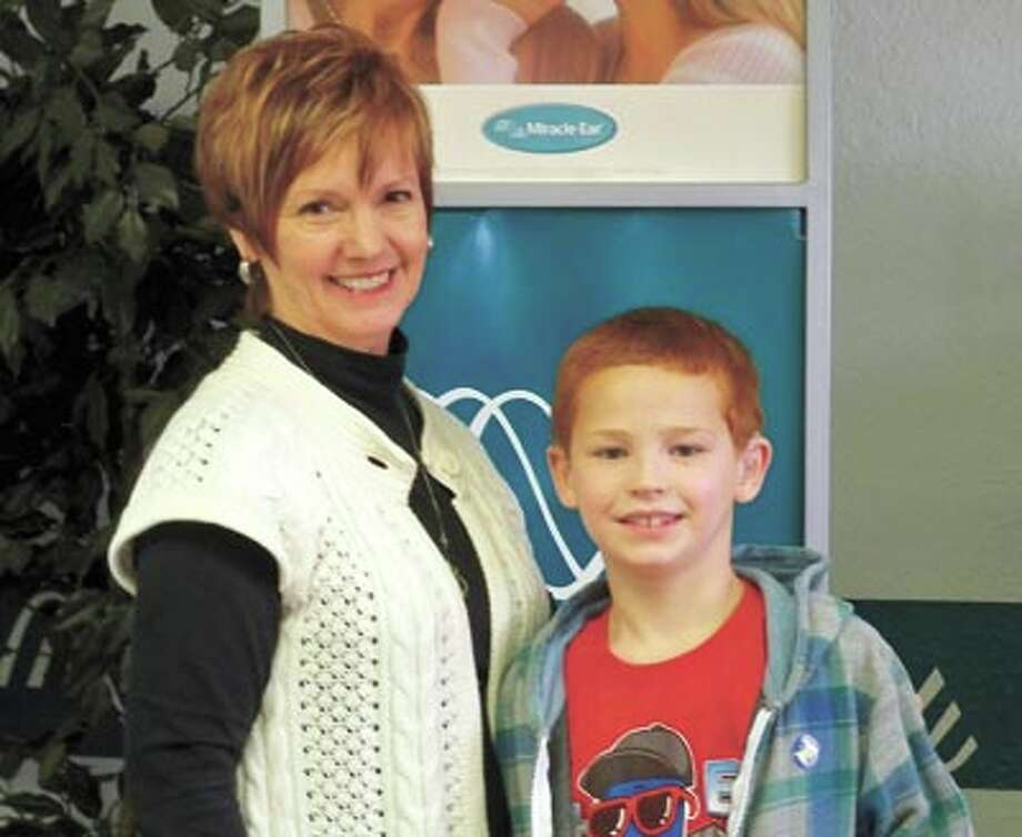 Miracle-Ear's Kay Scroggins fit John Van De Water of Monahans with hearing aids through the Miracle-Ear Foundation. Hearing loss in children can delay development and create difficulty in school and other environments.