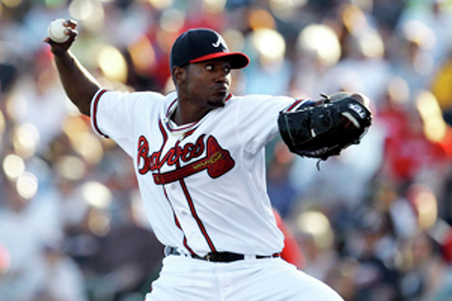 FILE - In this March 14, 2012, file photo, Atlanta Braves pitcher Julio Teheran throws against the Washington Nationals in the first inning of a spring training baseball game in Kissimmee, Fla. Forget about that ugly spring game when Teheran allowed six homers in two innings against Detroit, the 21-year-old right-hander is one of the majors' best pitching prospects. He went 15-3 with a 2.55 ERA in 25 games for Triple-A Gwinnett last season. (AP Photo/Paul Sancya, File) Photo: Paul Sancya / AP2012