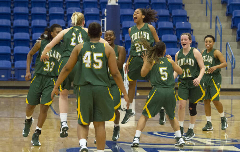 Midland College platers celebrate mid court after the Lady Chaparrals' 79-74 victory against Weatherford College on Saturday in the Rip Griffin Center in Lubbock. Photo: Brad Tollefson