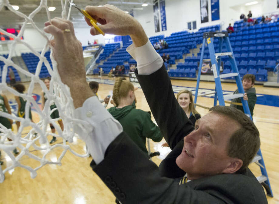 Midland College coach Ron Jones cuts down the net after the Lady Chaparrals' 79-74 victory against Weatherford College on Saturday at Rip Griffin Center in Lubbock. The victory secured the NJCAA Region V Tournament championship. Brad Tollefson/Special to the MRT Photo: Brad Tollefson