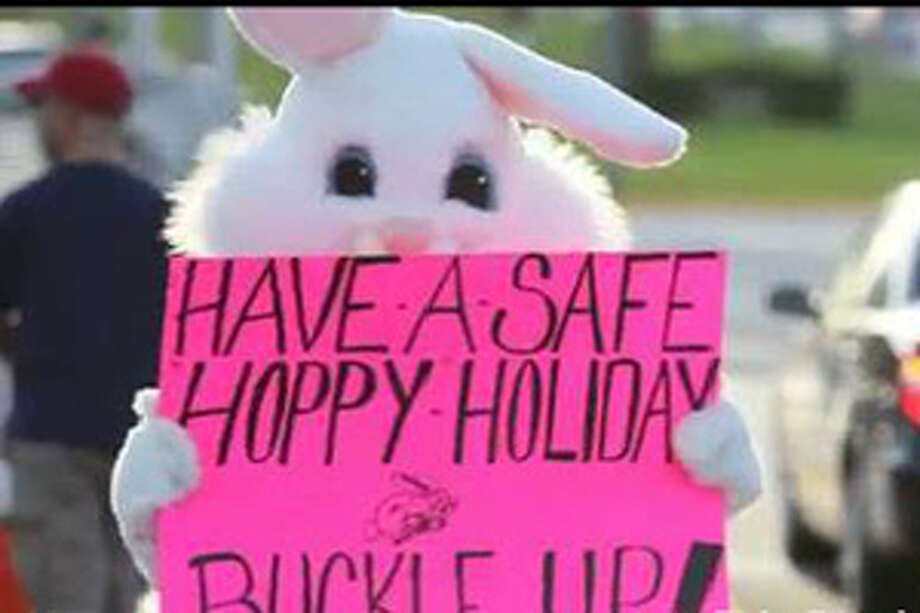 """According to the Palm Beach Post, a cop dressed in the costume Wednesday stood in a median with a sign that read """"Have a safe, hoppy holiday. Buckle up!"""" While bemused motorists waved, the costumed officer was secretly radioing others up the street with the license plate numbers of motorists who weren't wearing seat belts. Photo: Palm Beach Post"""
