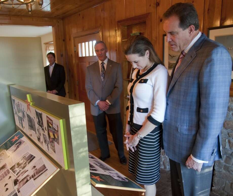 (File Photo) Jim Nantz and his wife Courtney visit the Bush Childhood Home Monday as executive director Paul St. Hilaire tells them some of the history of the home. Tim Fischer\Reporter-Telegram Photo: Tim Fischer