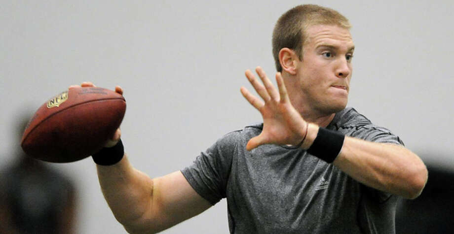 Texas A&M quarterback Ryan Tannehill throws a pass under the scrutiny of NFL football scouts during his pro day held in College Station, Texas, Thursday, March 29, 2012. (AP Photo/Bryan-College Station Eagle, Dave McDermand) Photo: Dave McDermand / Bryan-College Station Eagle