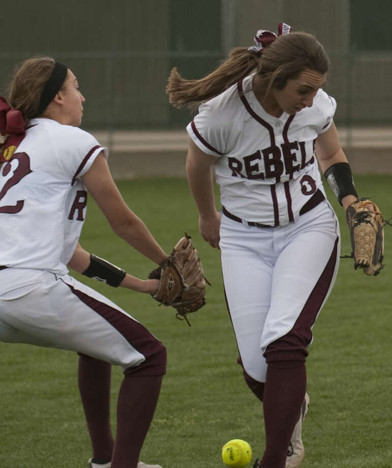 Lee's Kylie Herring, left and Ciara Sheppard nearly collide as they both go after a fly ball Saturday against Midland High. Tim Fischer\Reporter-Telegram Photo: Tim Fischer