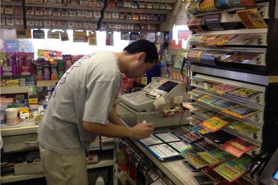 Terry Taing changes the estimated jackpot for Friday's Mega Million lottery from $500 million to $540 million Thursday at Mr. T's Market in Midland. The prize has continued to soar to record highs as hopefuls swarm to convenience stores across the U.S. Photo: Sara Higgins | MRT