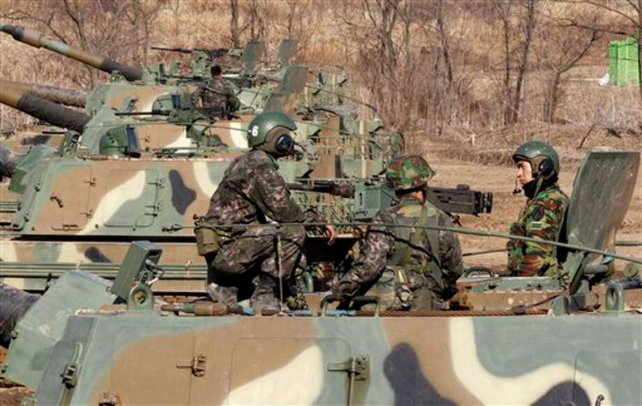 South Korean Army soldiers sit on their K-9 self-propelled artillery vehicle during an exercise against possible attacks by North Korea near the border village of Panmunjom in Paju, South Korea, Monday, March 11, 2013. South Korea and the U.S. on Monday kicked off an annual military drill amid worries about a possible bloodshed following North Korea's threat to scrap a decades-old war armistice and launch a nuclear attack on the U.S. (AP Photo/Ahn Young-joon) Photo: Ahn Young-joon / AP