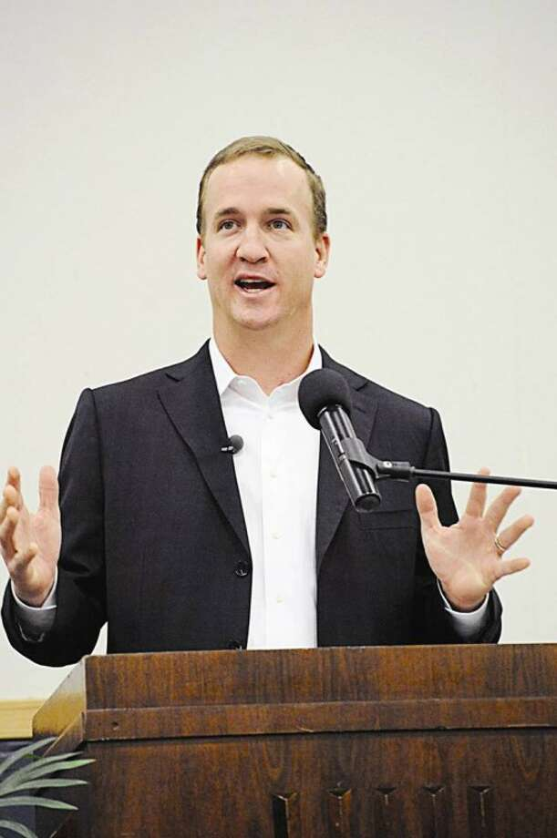 Peyton Manning speaks at the Tyding Auditorium in Hobbs, N.M., as part of the Jack Maddox Distinguised Lecture Series on Thursday. Hobbs News-Sun Photo