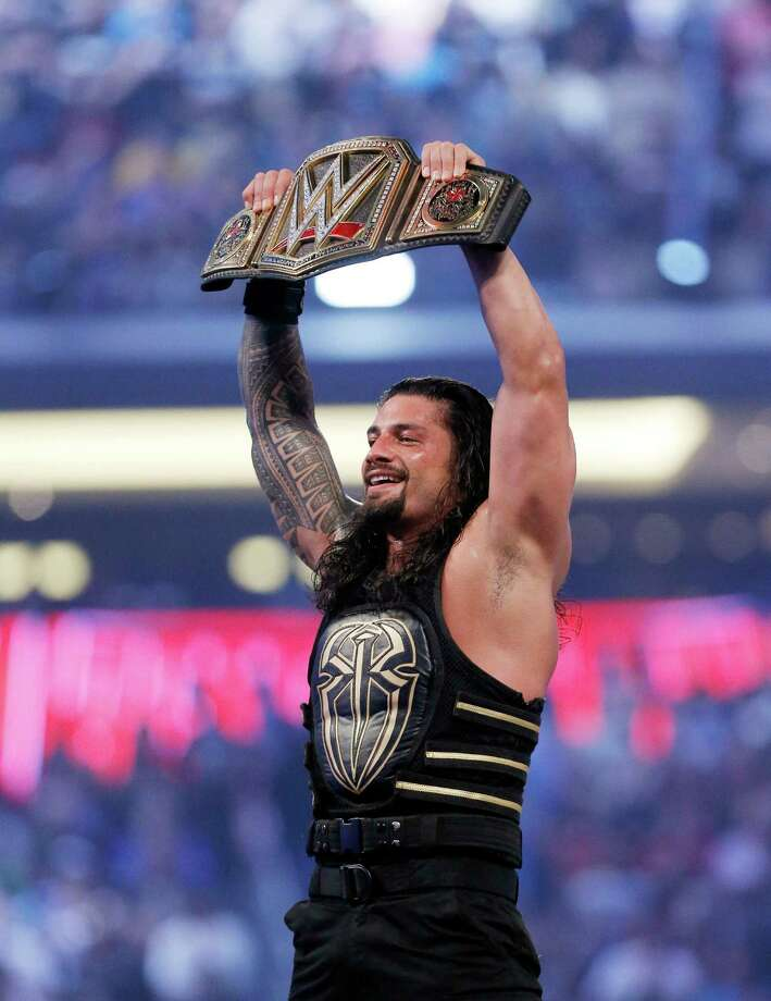 On April 3, 2016, Roman Reigns celebrates his victory at WrestleMania 32 at AT&T Stadium in Arlington, Texas. (Brandon Wade/AP Images for WWE) Photo: Brandon Wade / AP Images For WWE / AP Images