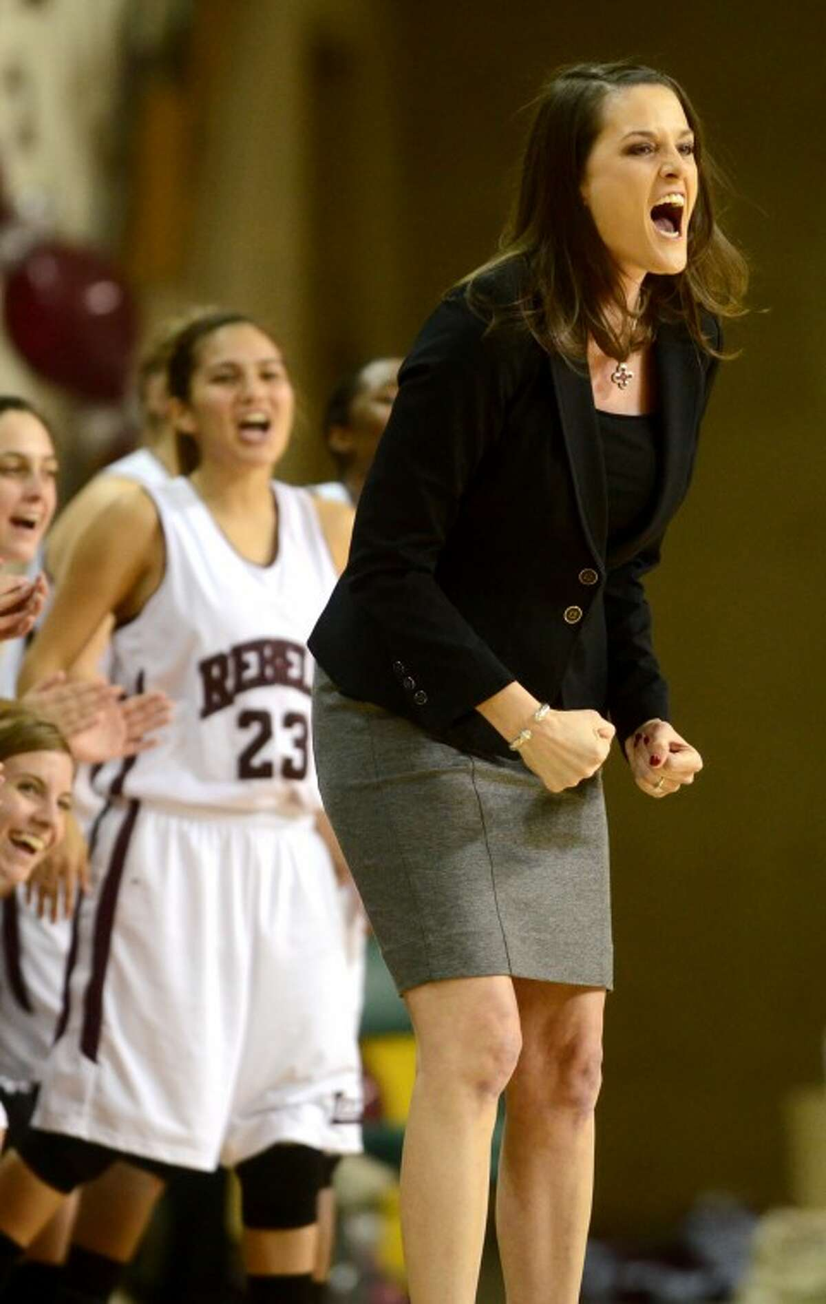 Lee High girls basketball head coach Morgan Fowler reacts to a play during the game against Midland High on Dec. 4, 2012 at the Chaparral Center. James Durbin/Reporter-Telegram