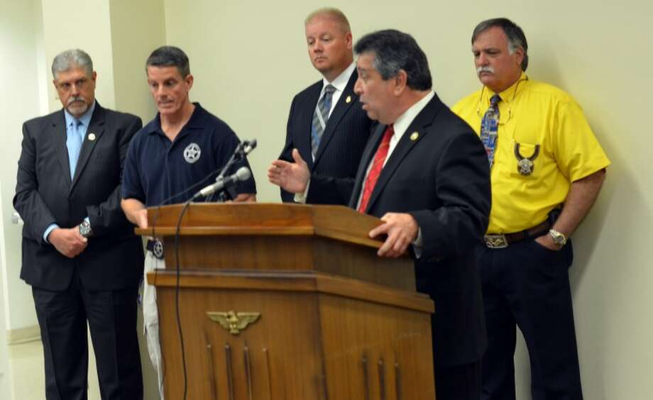 (File Photo) Robert Almonte, U.S. marshal for the Western District of Texas, counter-clockwise; Ector County Sheriff Mark Donaldson; Gary Garnett, Homeland Security agent; Steve Clark, U.S. marshal; and Phill Maxwell, supervisory deputy U.S. marshal are members of the  Lone Star Fugitive Task Force. The group announced Friday it had arrested 65 Ector County fugitives. Photo: James Cannon/MRT