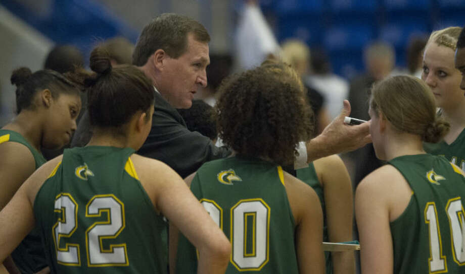 Midland College coach Ron Jones talks to his team before the Lady Chaparrals' game against the Weatherford College Lady Coyotes on Saturday in the Rip Griffin Center in Lubbock. Photo: Brad Tollefson